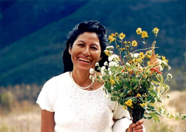 mexican-woman-with-flowers-1253228-639x451.jpg