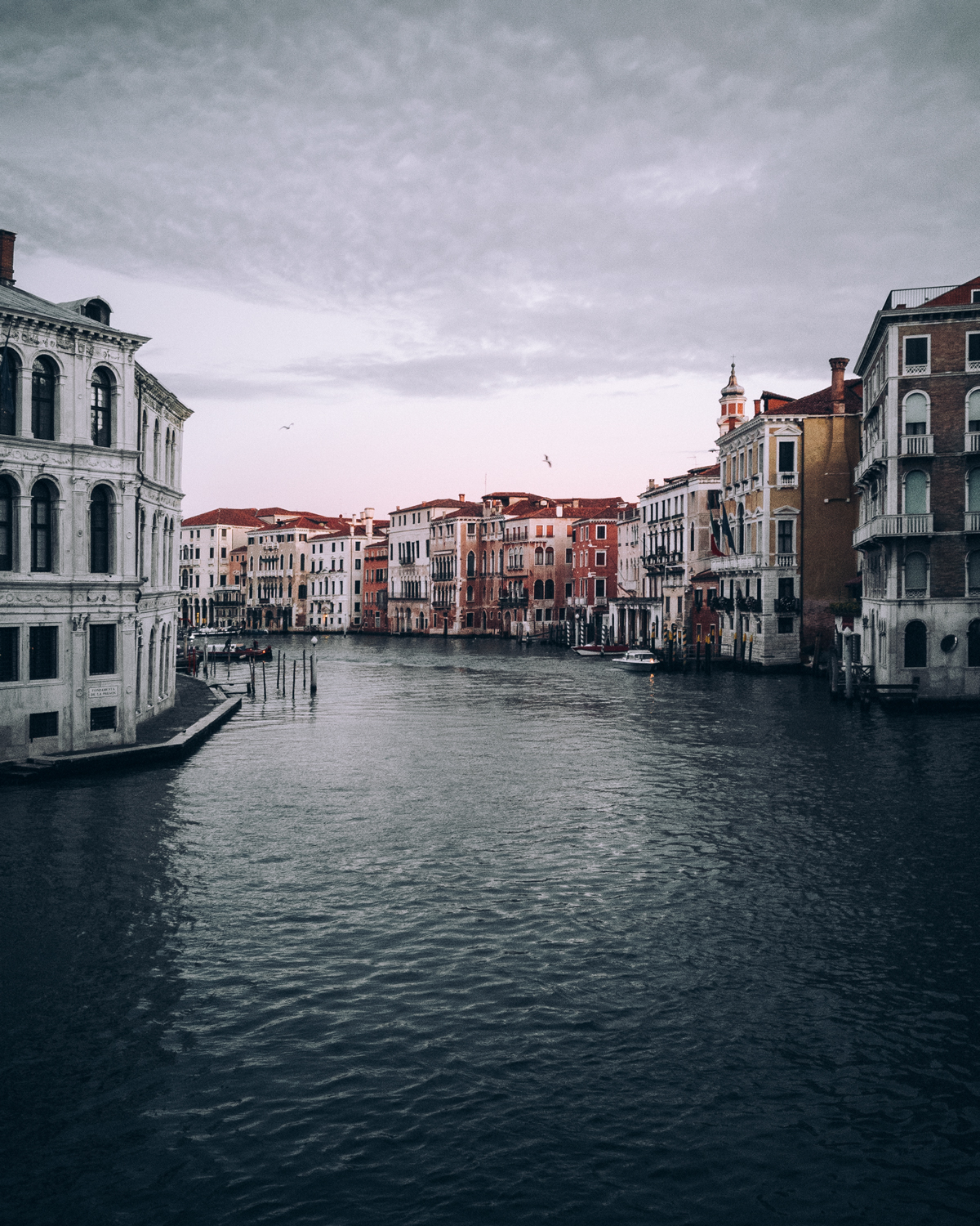 """Very clean and simple composition photographed in Venice, Italy. Personally I would not choose this image as the """"subject"""": the buildings by the water become less pronounced through the small amount of space they take."""
