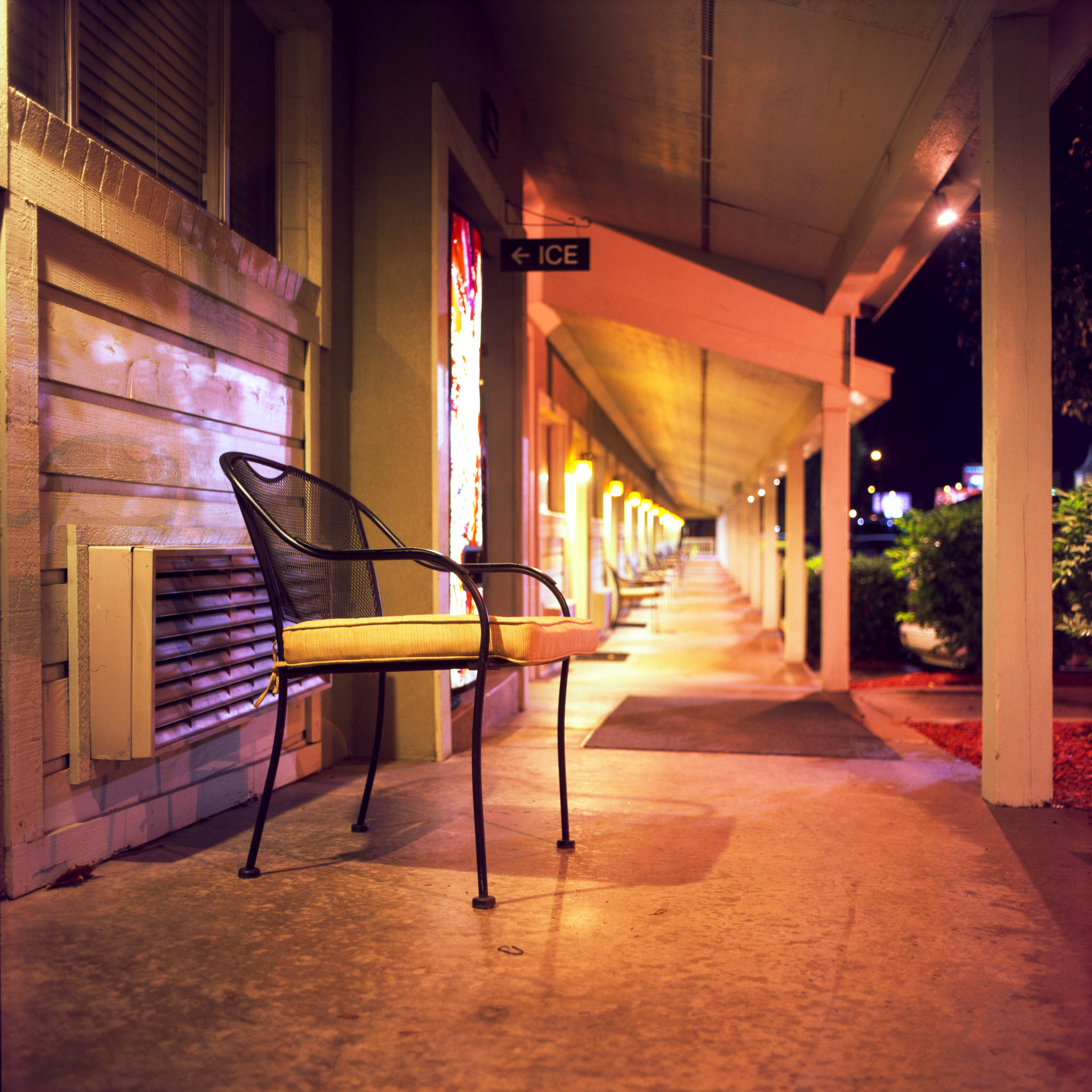 A chair sits outside the vending machine at the motel.