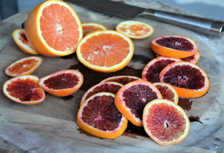 Thin slices of blood oranges to top the almond cake.