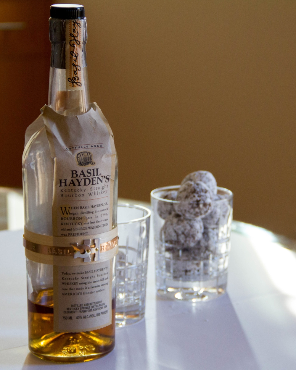 Any bourbon or whiskey or rum of your choosing can be subbed in the recipe
