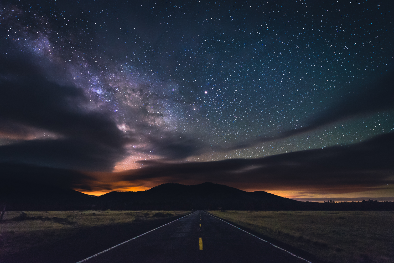 Being out in the middle of night, can be a little bit scary. This night, in particular, i was out solo, 30 miles north of Flagstaff with no sign of life...haha. The solitude, however, allowed me to take this picture right in the middle of the road looking south. Notice Mars shining bright almost directly above the yellow line, and the galactic plane of the Milky Way peaking through on the left