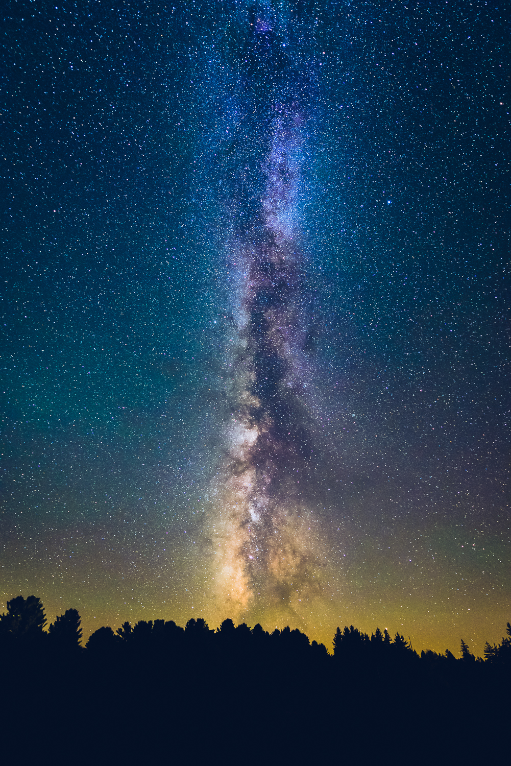 Milky Way plane arching high above us, rising from the SW horizon around 12:45am