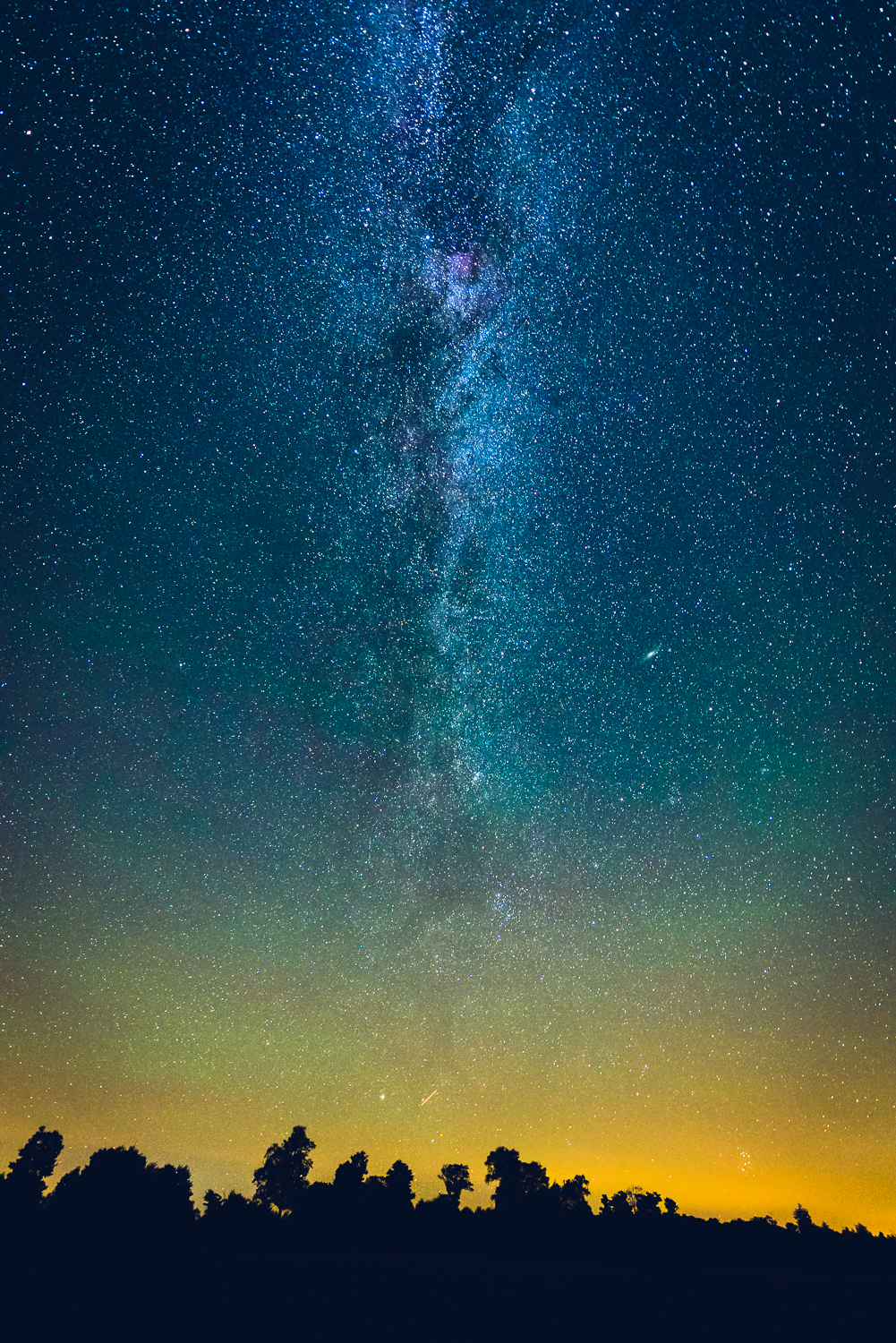 Milky Way arch completing its horizon to horizon stretch at the NE horizon, notice the Andromeda Galaxy as a small but bright disk in the center of the photo to the right of the Milky Way Galactic plane