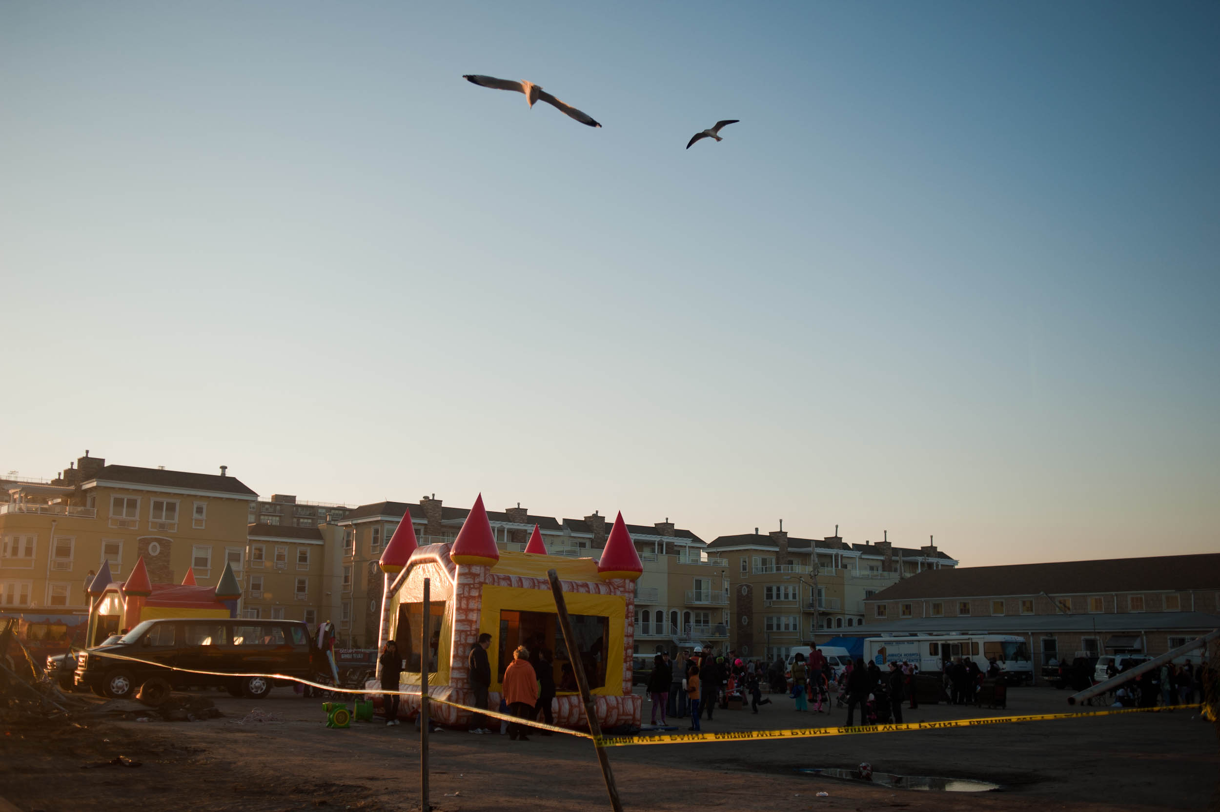 (November 17th 2012) Three weeks after Hurricane Sandy, grassroots organizations held a carnival for the children of Far Rockaway, giving them a break from the wreckage and destruction that surrounded them. As the sun sets, many of them leave the cheerful event only to return to their homes that were still without power. (2 of 3)