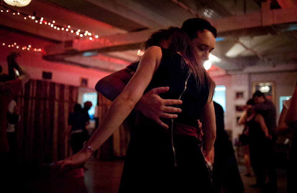"""Two dancers in the NYC Fusion dance community find a close embrace during a """"Melting Pot"""" social dance on a Saturday night."""