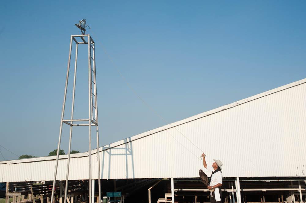 "(June 2012) Member of the Osage community rings the bell signally the beginning of the Pawhuska ""I'n-Lon-Schka"" annual ceremonial dance."