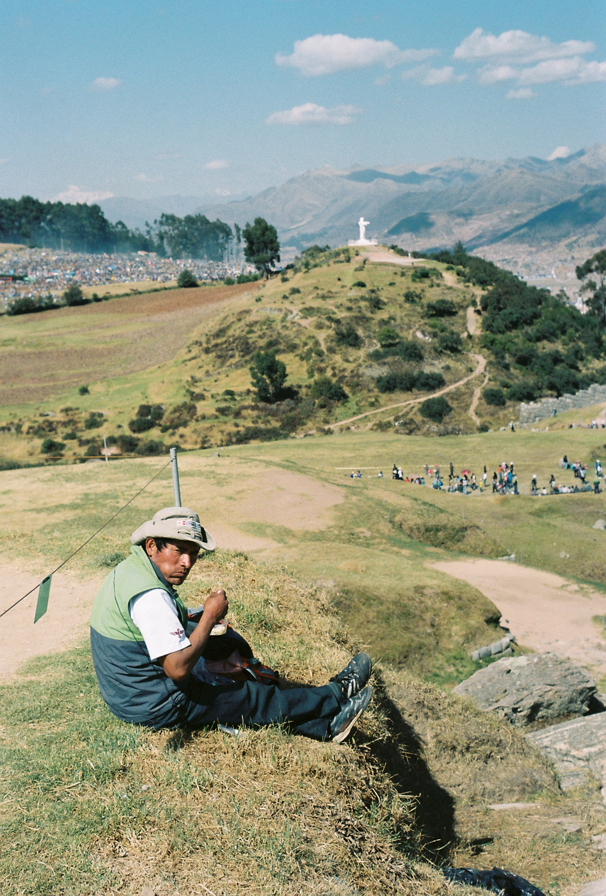 (June 24th 2015) A local finds a spot away from the crowd for a lunch break during the ceremonial events of Inti Ryami, the Festival of the Sun, held at the top of the historical Incan fortress of Sacsayhuaman.