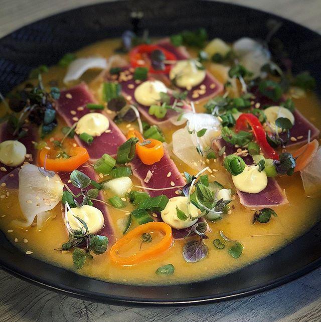 Tiradito Nikkei - seared ahi tuna, passion fruit, sesame seeds, daikon and Nikkei Aioli