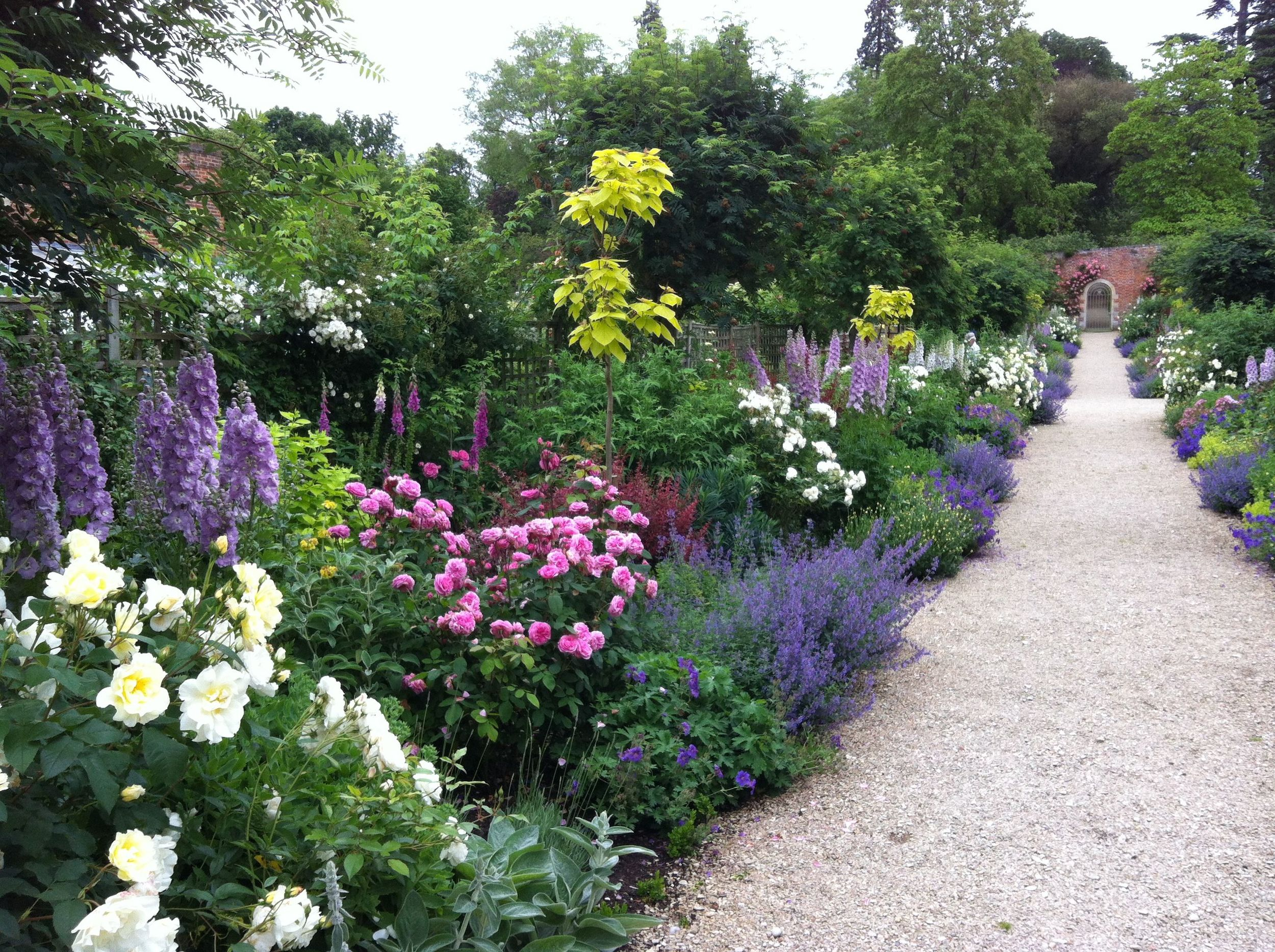 The Peter Coats Border at Buscot Park - a mixed shrub and herbaceous border, producing colour from tulip season through to Autumn shades.