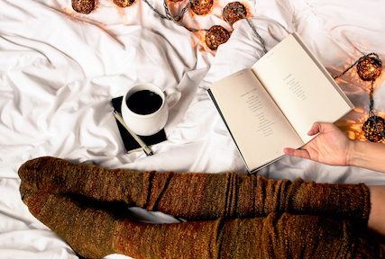 This will be me, minus the coffee because #tea and swap the poetry for  The Life of Pi which I'm just now reading. PC:  Thought Catalogue on Unsplash