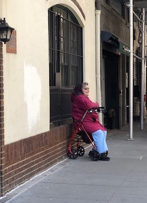 """This is Tracy. Most weekends she's out on East 8th Street calling out """"Have a great day!"""" to everyone who walks by. Getting well wishes from her always makes my Sunday a good one."""