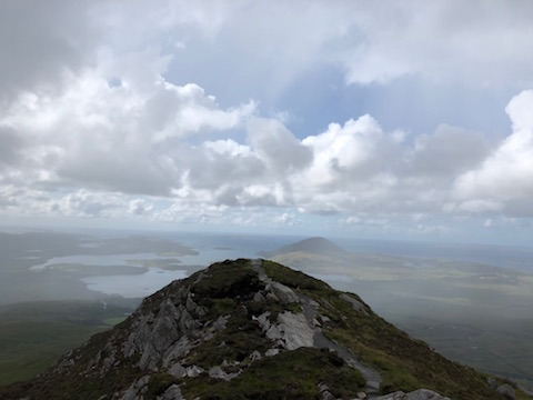 Diamond Hill in Connemara National Park (Ireland). 1,450 feet up and I hiked each bit of it.In the rain.Wearing sneakers.On a whim.  Alternative caption: A respite from the car.
