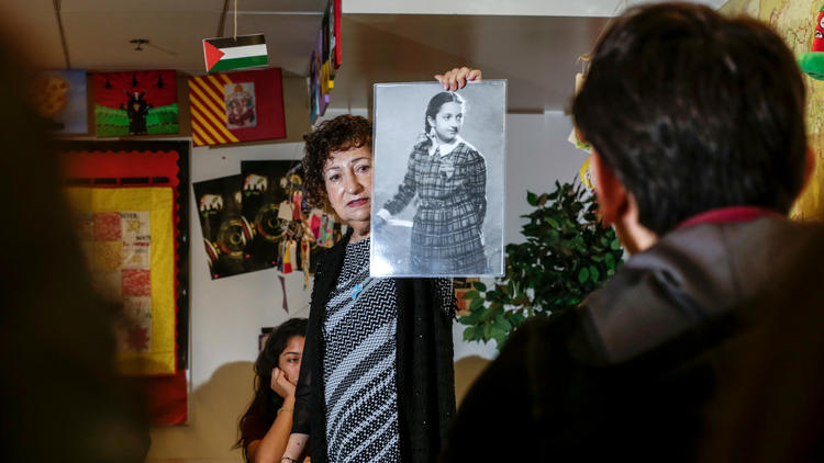 Gabriella Karin, who spent part of World War II in hiding from the Nazis, speaks to students at Animo Ralph Bunche High School about her experiences. (Irfan Kahn / Los Angeles Times)