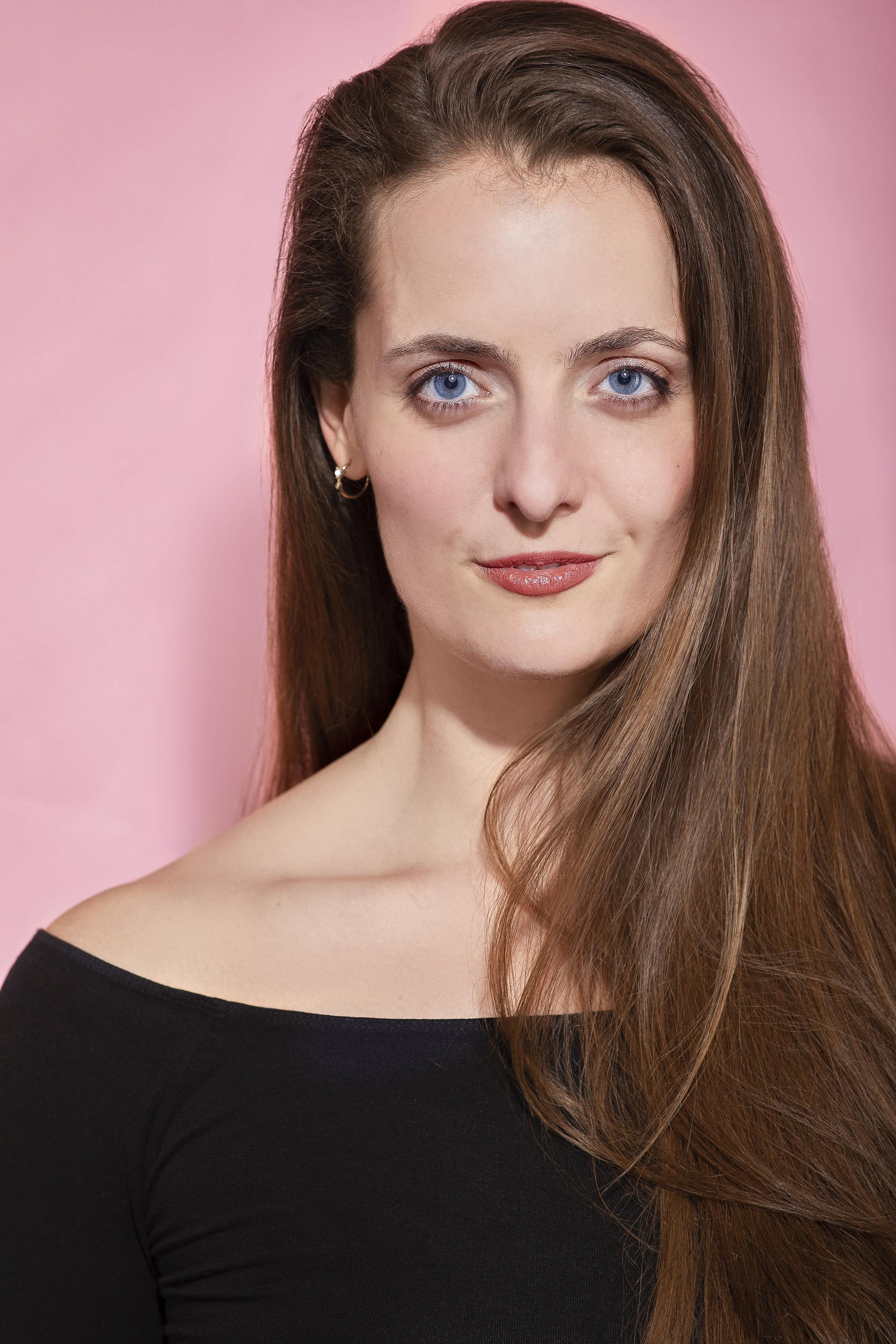 Laura Vogels HeadshotPink.jpg