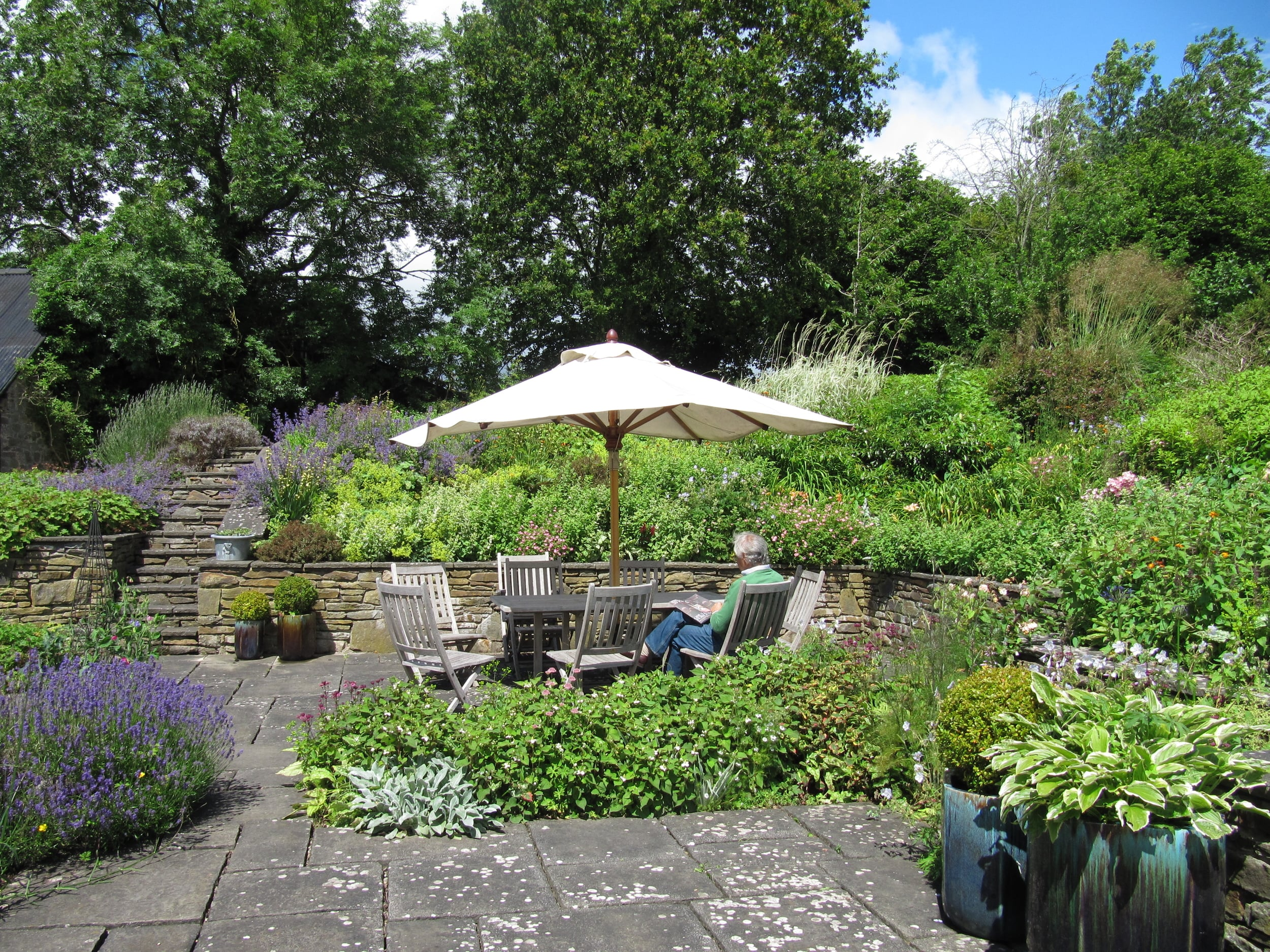 A sunny terrace surrounded by scented herbs and hardy geraniums makes a relaxing space to dine or just to take the air.