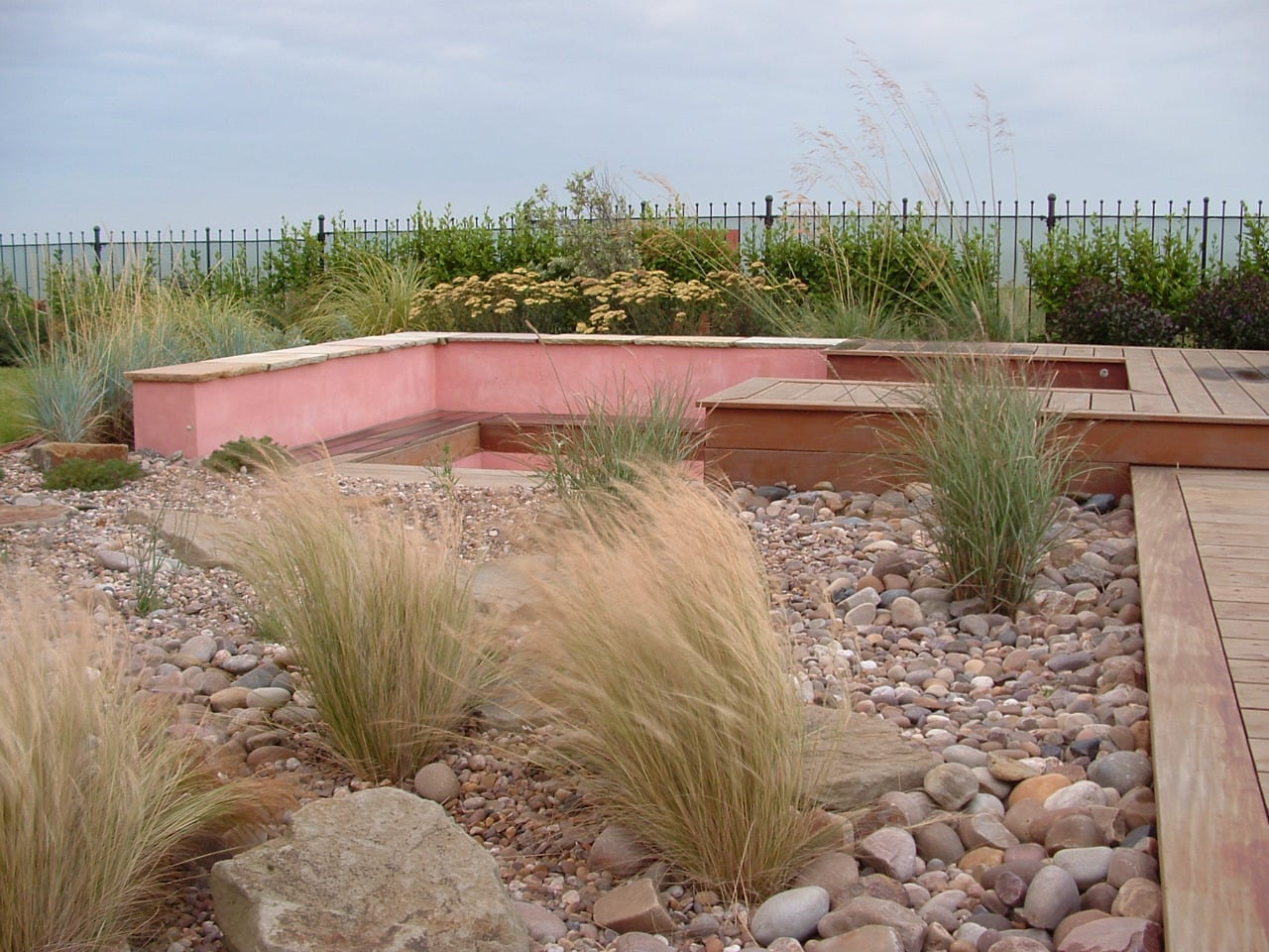 A 'pebble beach' garden with sunken sitting area out on the windswept headland at Barry Island.