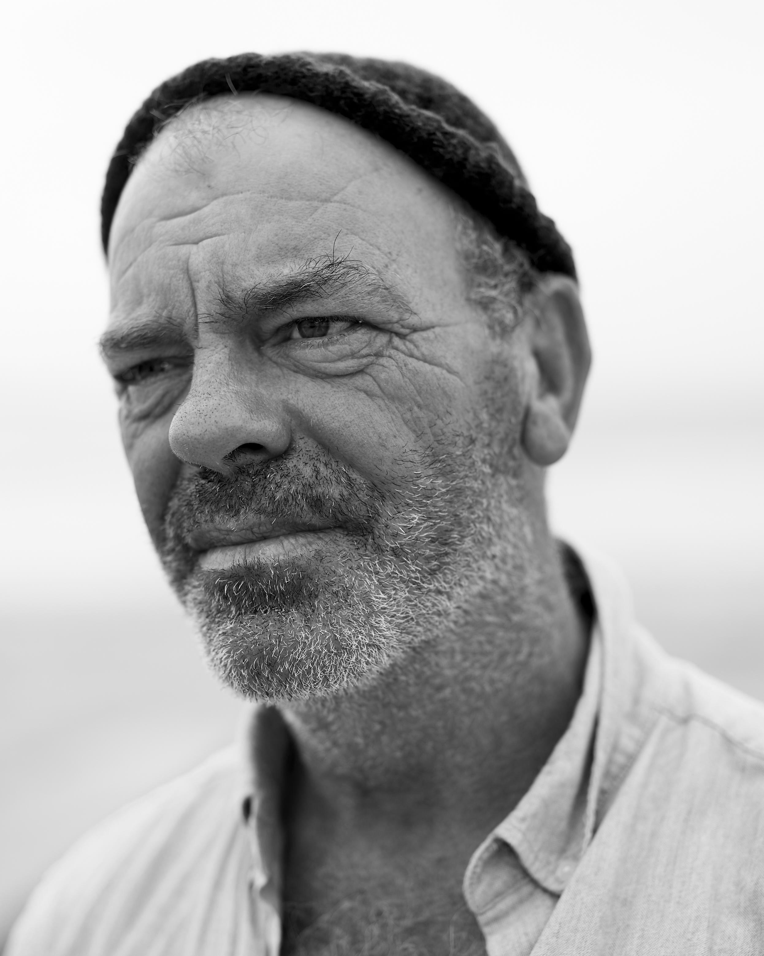 Steve Bateman, A true 'Guern', fisherman, doorman, labourer, chef and all round character, photographed off Vazon beach, Guernsey
