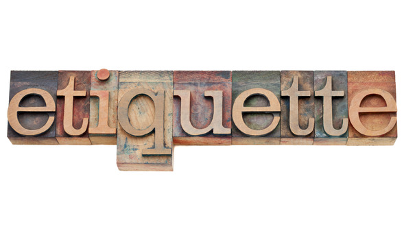 "Different colored letter blocks spelling out the word ""etiquette"""
