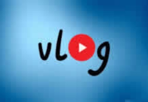 """Vlog"" logo on a mixed dark and light blue background"