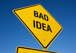Photo of a yellow diamond road sign reading BAD IDEA