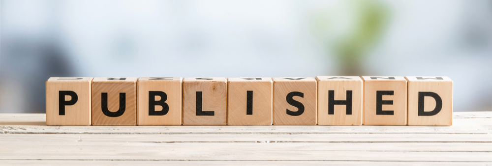 """The word """"PUBLISHED"""" spelled out on wooden letter cubes"""