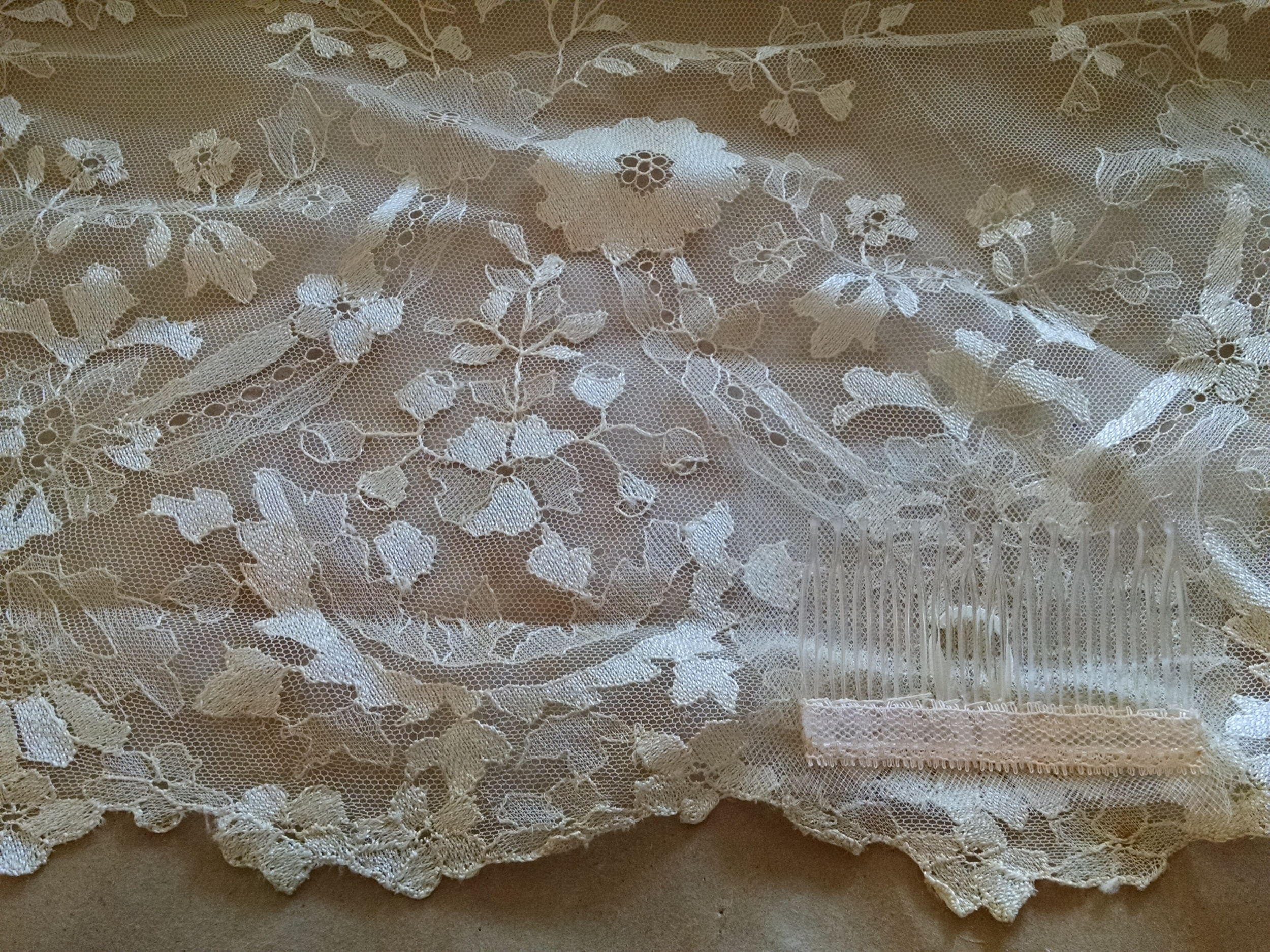 Antique lace from Spain with a new added comb and invisible tulle reinforcement.