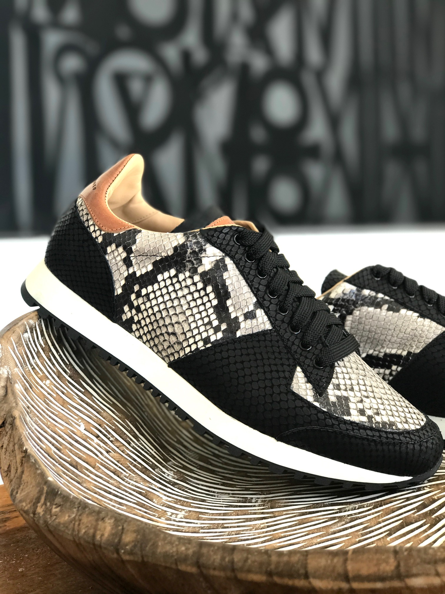 How would you describe the brand's aesthetic? - The brand focuses on creating a laid back luxurious aesthetic. It has a very versatile design that you can wear dressed up or down depending on your mood. A perfect example of what we do is creating runners with back support enabling you to walk as an athletic sneaker for its comfort but designed and meticulously handcrafted by hand with noble materials and skins such as Pythons to give it the luxurious feel.