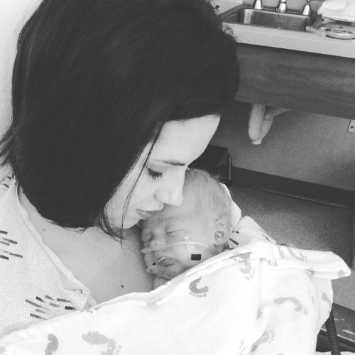 The first time Kelly got to hold Knox. He was still in ICU and Kelly had just finished recieveing two blood transfusions.
