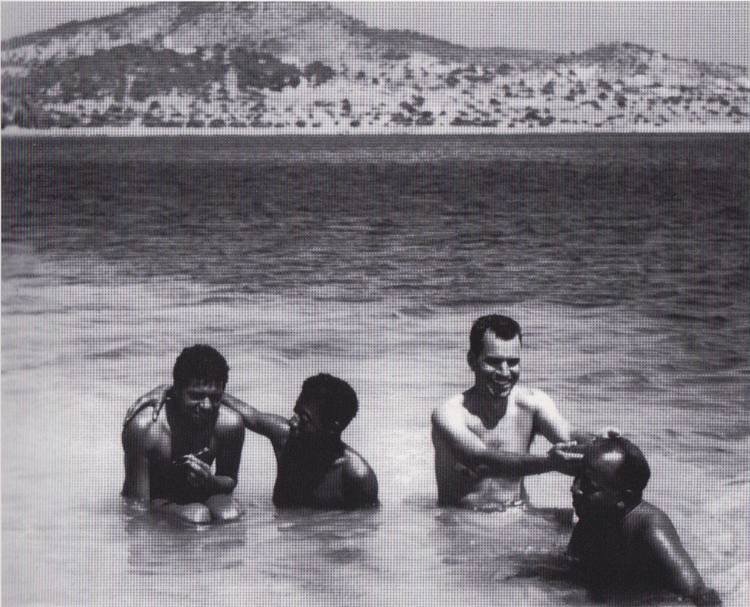 """Photograph by Leslie Schenk of (l-r), """"Arnold"""", James Baldwin, Lawrence Calcagno, and Beauford Delaney in Ibiza, Spain, 1956. Courtesy of David Leeming, and illustrated in,  An Artistic Friendship: Beauford Delaney and Lawrence Calcagno."""