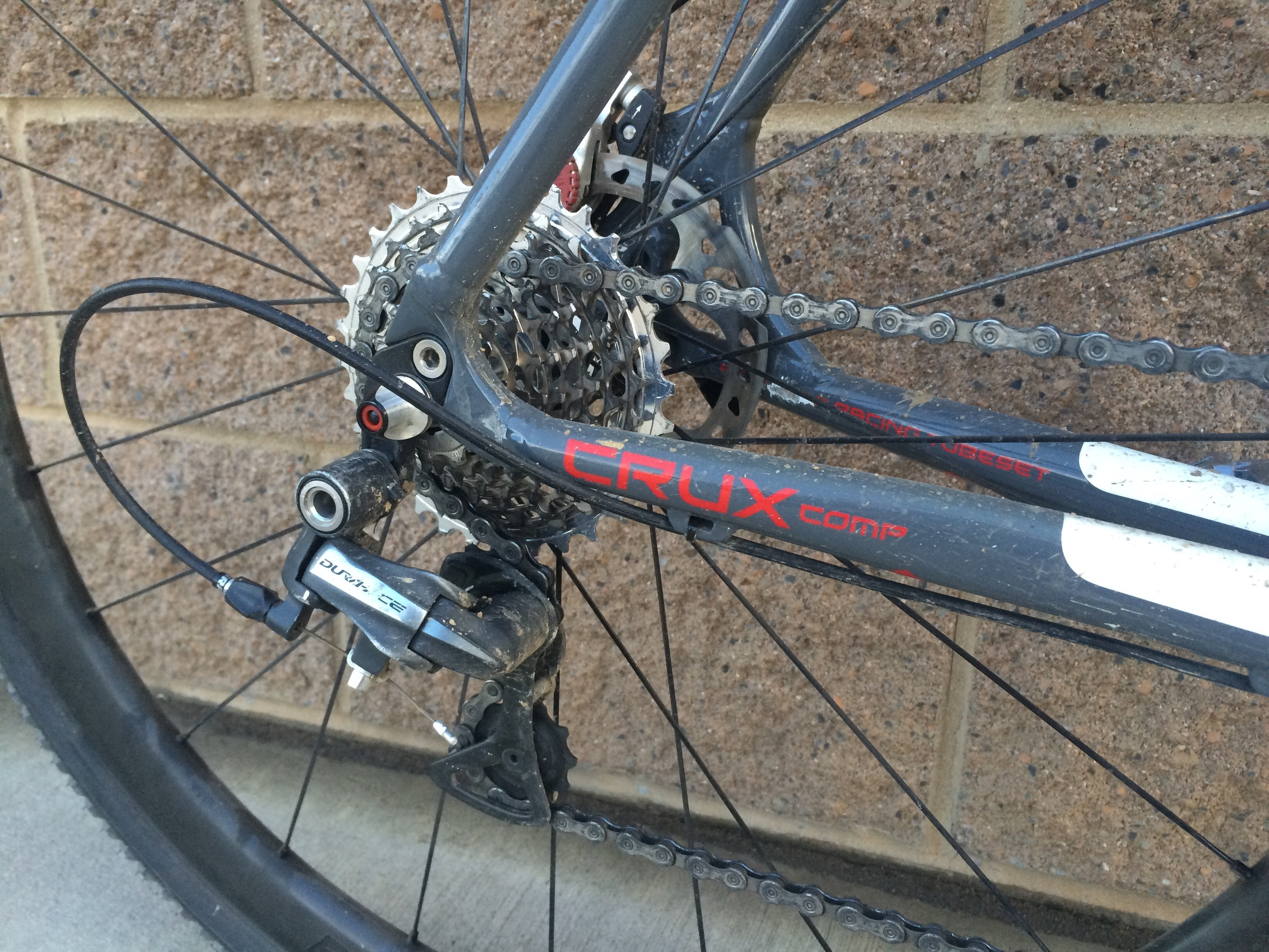 10 spd Shimano derailleurs and shifters with a fancy SRAM Red 11x32 cassette. It's not supposed to work but it does.