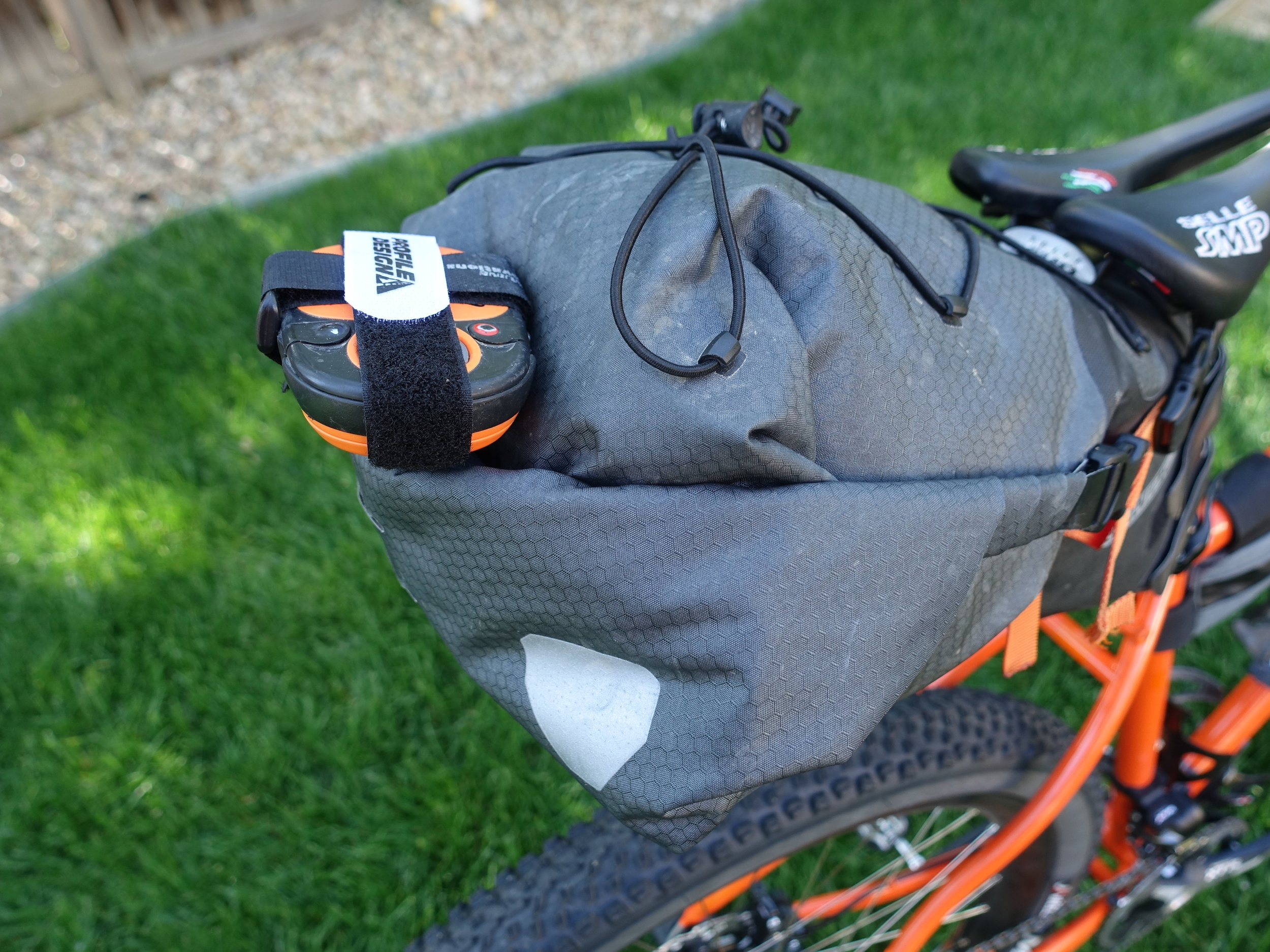 Using the light mounting points on the Ortlieb Seat Pack to mount my Spot Tracker. With an old Genuine Innovations Big Air mounting block and a couple Velcro straps I have a nice, secure way to carry it and with a good line of sight to the sky.