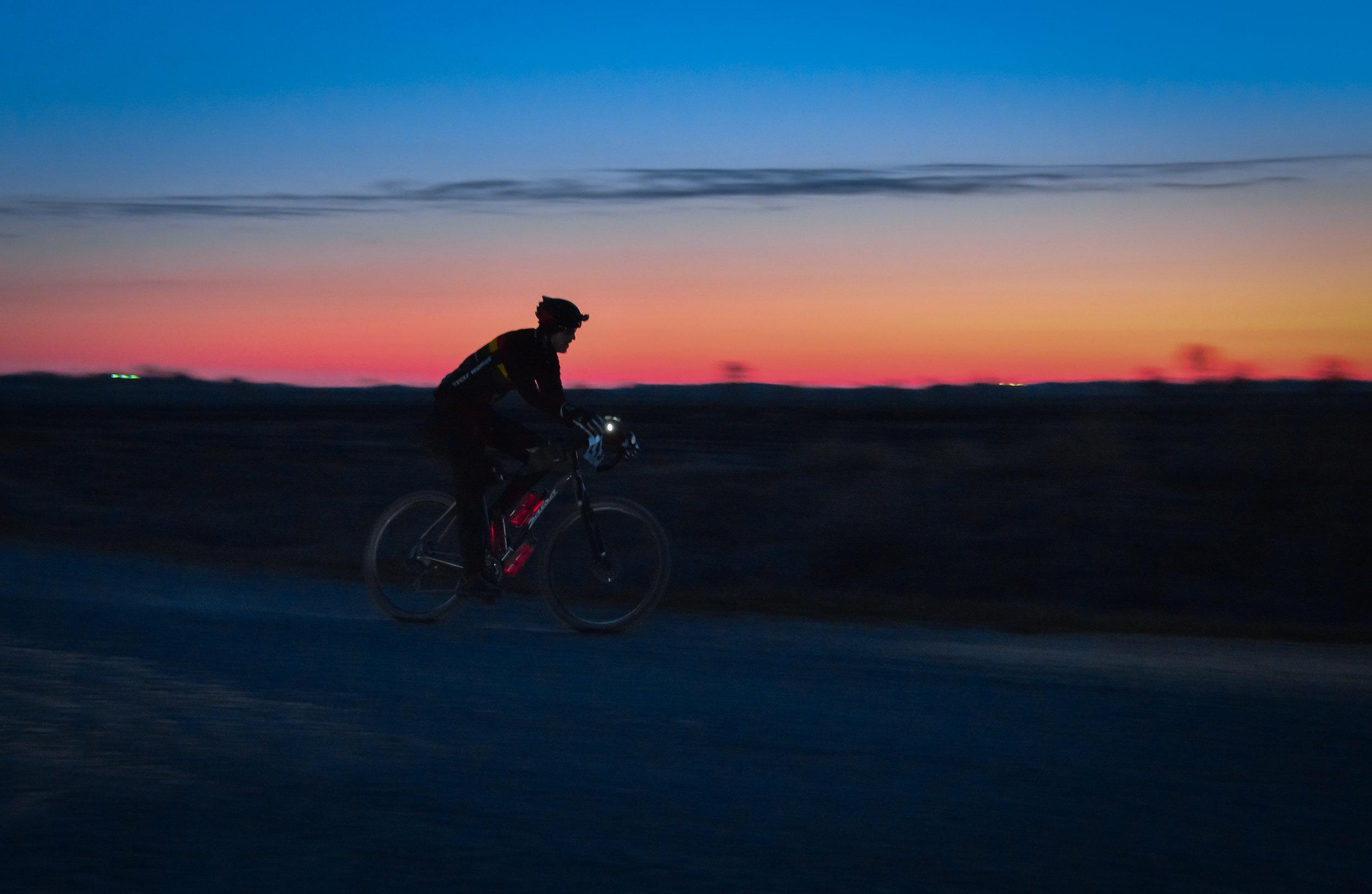 "Corey ""Cornbread"" Godfrey rides from night into day at TIV14. Gorgeous photo courtesy of Jon Duke."