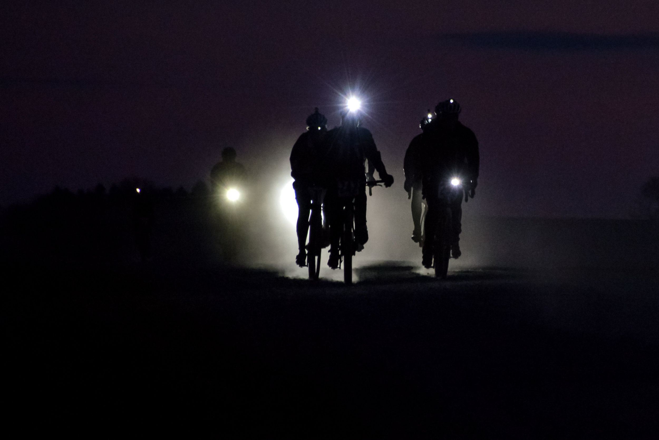 Riding gravel at night can be a wonderfully focused experience. Sharing the dark miles makes them a little brighter. Photo by Jon Duke.