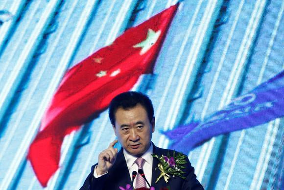 Dalian Wanda Chairman Wang Jianlin's global shopping spree came to an abrupt halt, with Beijing curbing capital outflows. © Reuters