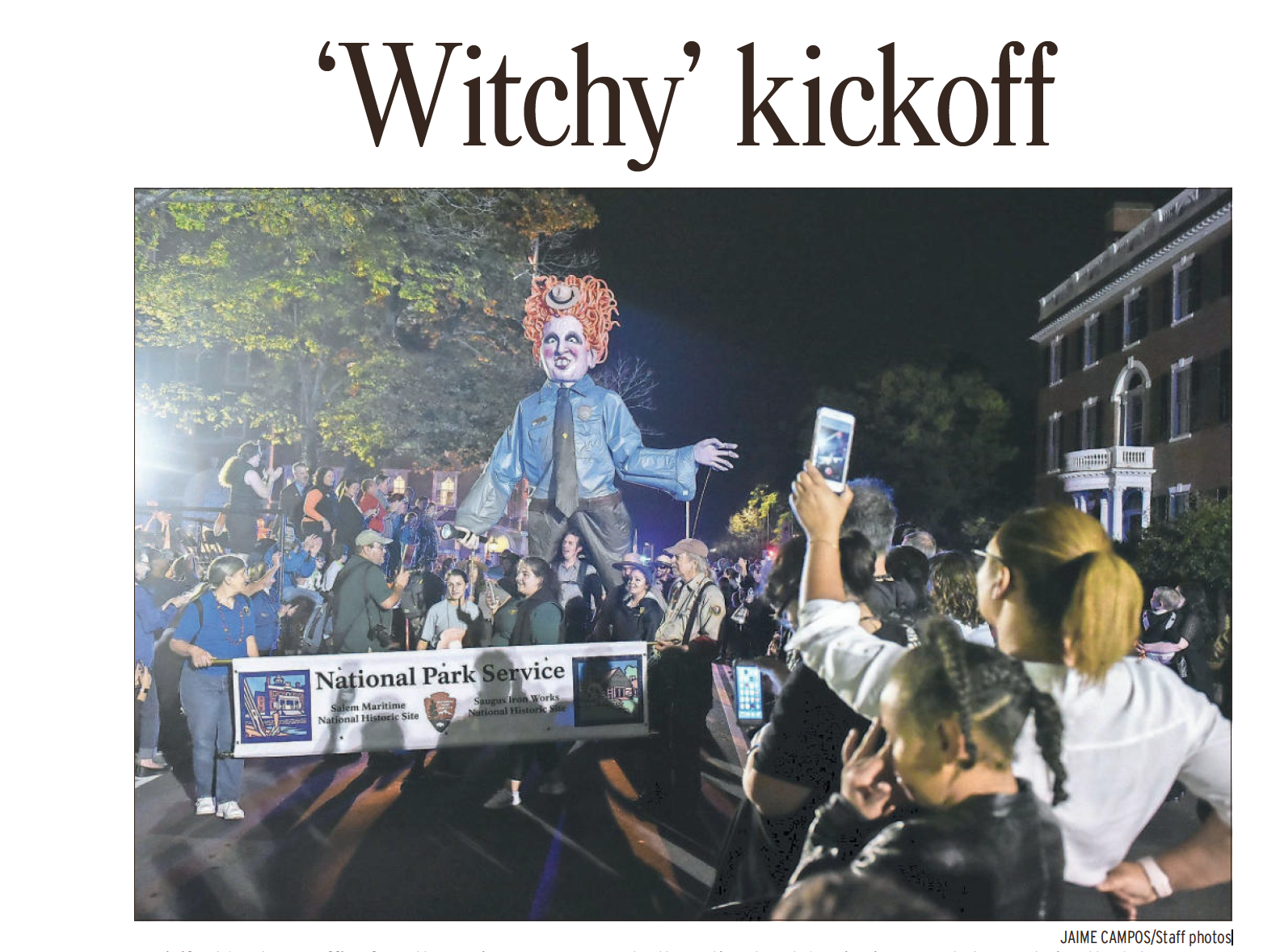 """Winifred Sanderson from the cult classic film """"Hocus Pocus"""" takes a job with the National Park Service and makes the front page of the Salem News, after parading through the crowds at the yearly Haunted Happenings Grand Parade in Salem, Massachusetts."""