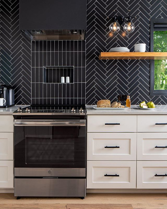 The little black dress of kitchens.  Light fixture by @illuminatevintage  Tile by @interceramicusa  Tile install by @nuckels_tile  Photo by @robert_gomez  Stay here on Airbnb @sococasita