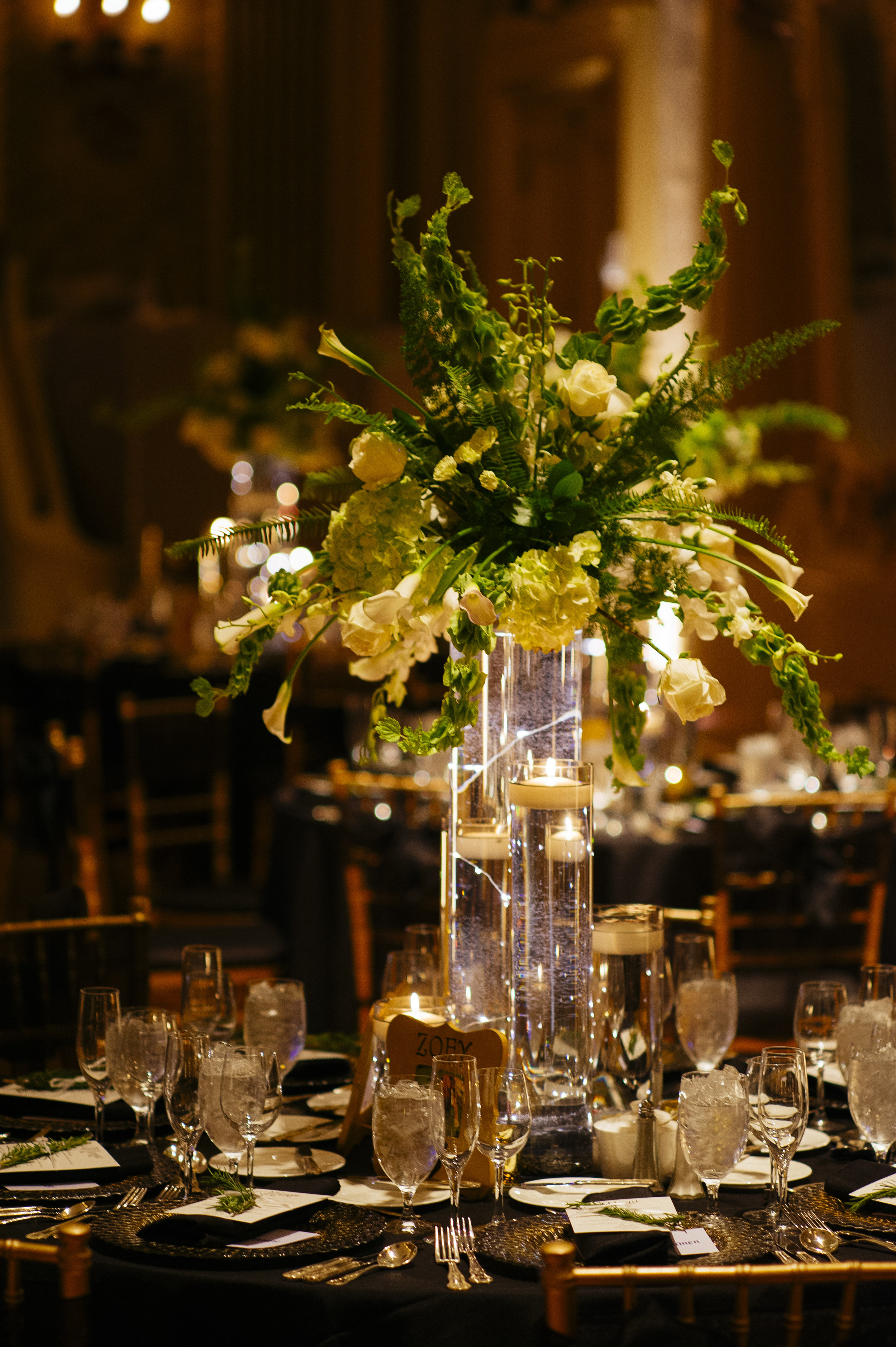 Hotel DuPont Wedding Centerpiece Bells of Ireland Roses Tulips Green and White Candlelight.jpg