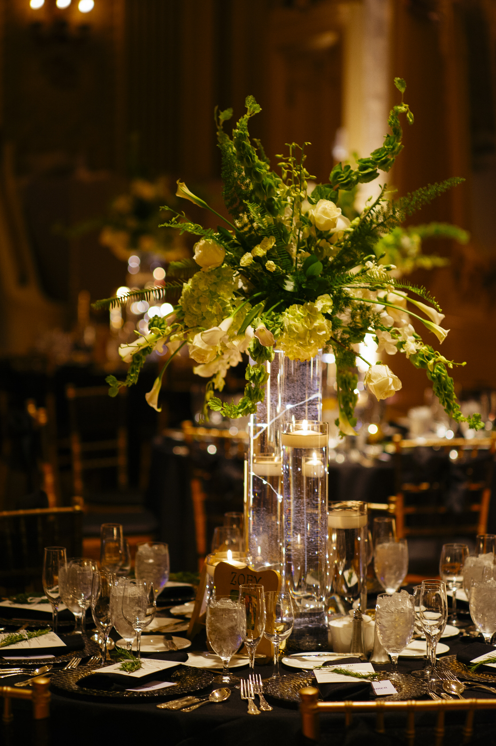 26 Hotel DuPont Wedding Centerpiece Bells of Ireland Roses Tulips Green and White Candlelight.jpg