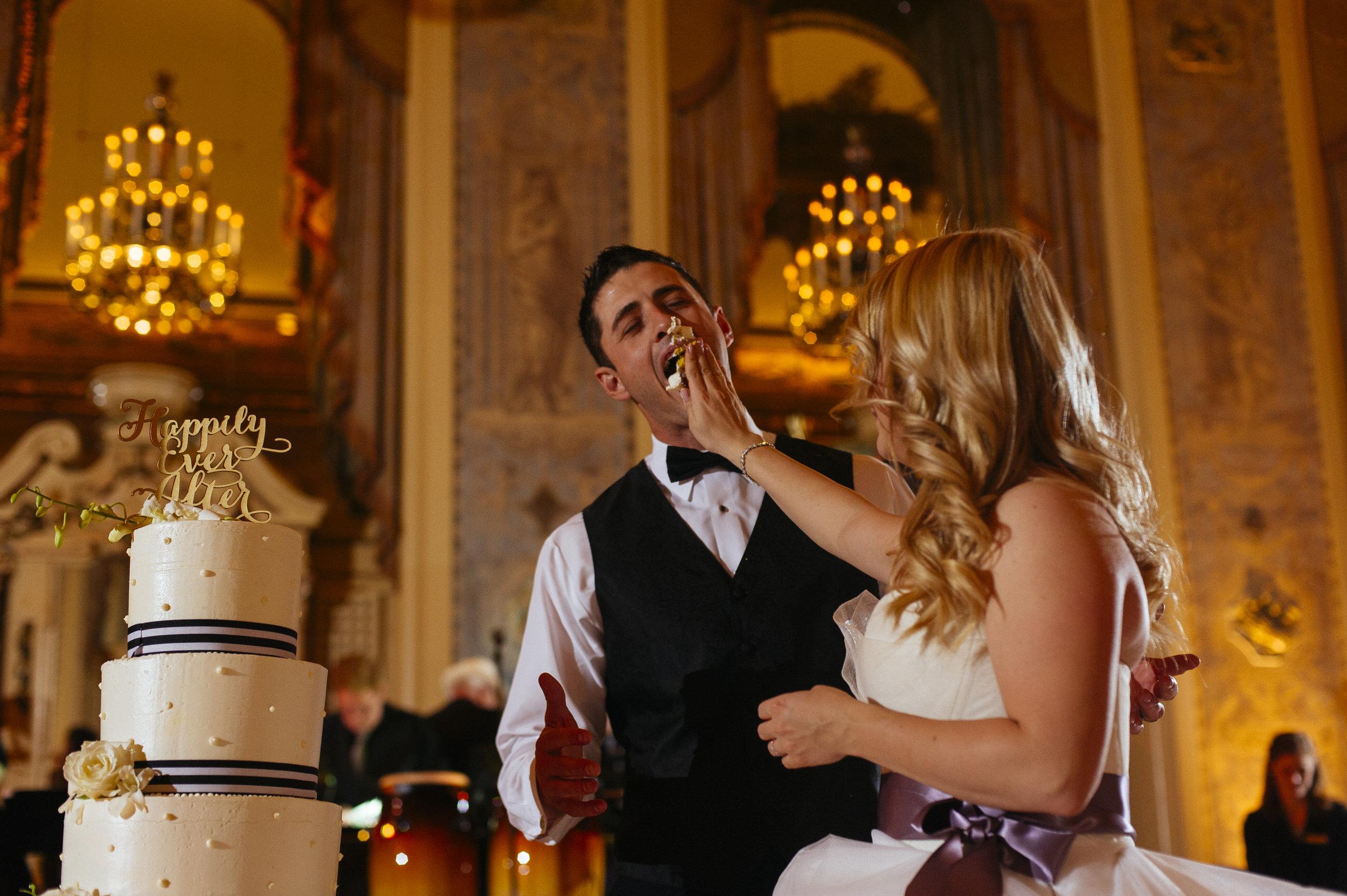 31 Hotel DuPont Wedding Smashing the Cake.jpg