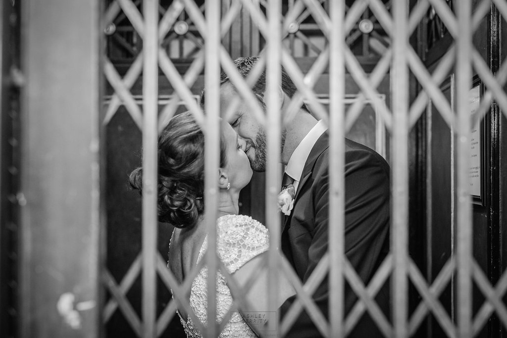 33 Philadelphia Wedding Stotesbury Mansion Elevator Kiss.jpg