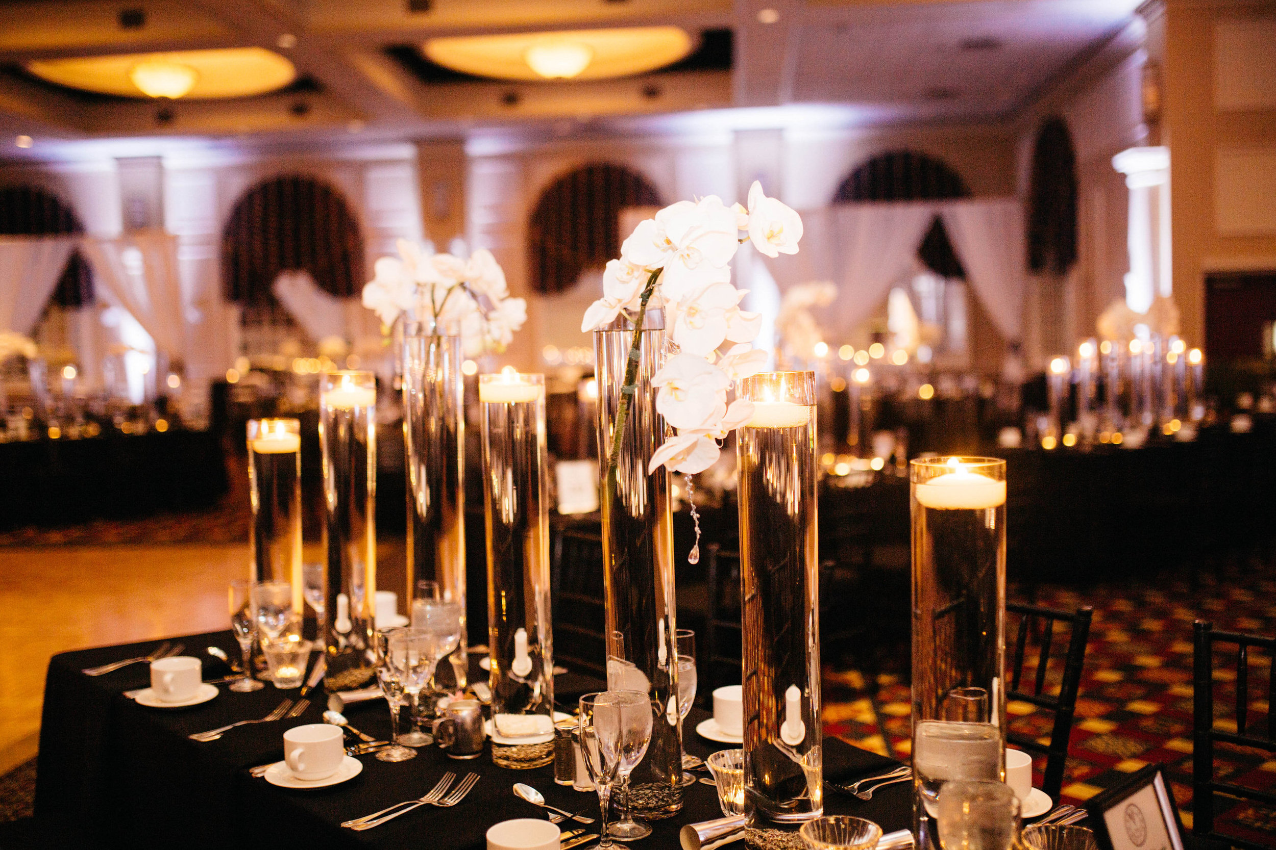 24 White Orchids Floating Candles Black and Silver Wedding.jpg
