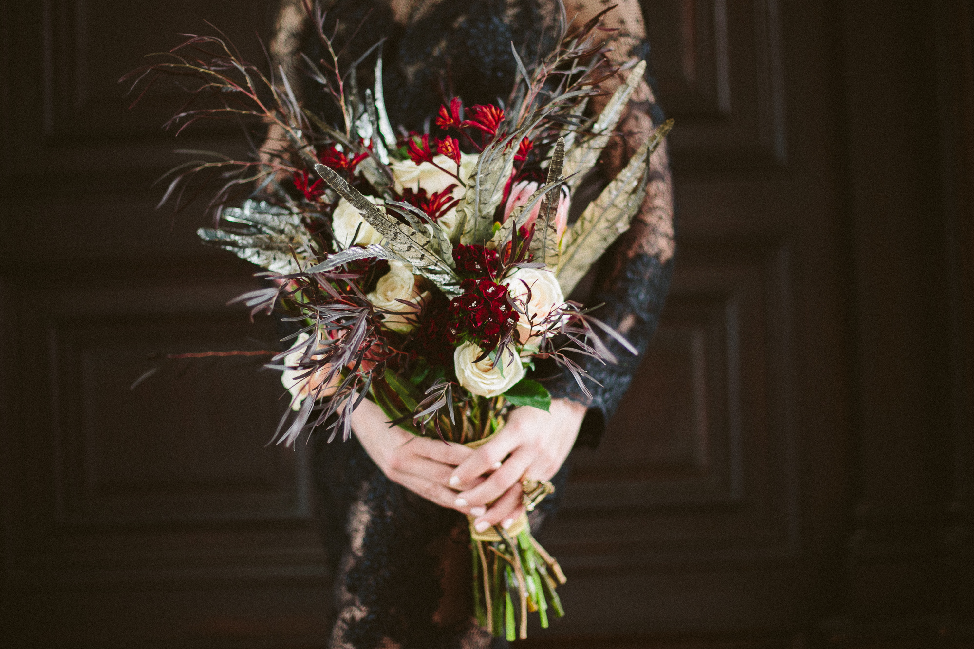 17 Evil Queen Wedding Bouquet Black Feathers Gold Feathers Black Lace Aribella Events.jpg