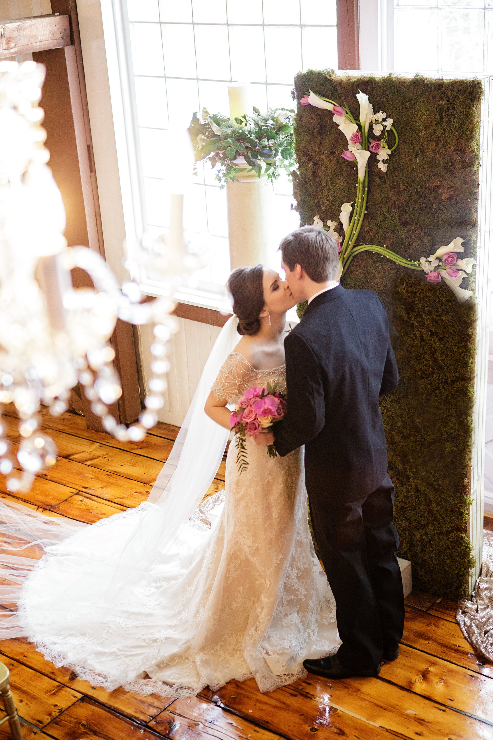 09 Ceremony Kiss Chandelier Monogram Backdrop.jpg