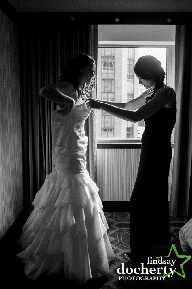 03 Philadelphia Wedding Sofitel Wedding Bride Prep Sisters Dress.jpg