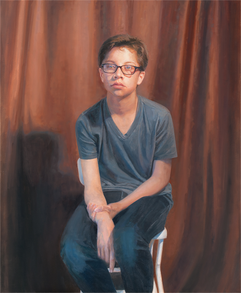 Cole Seated on White Chair