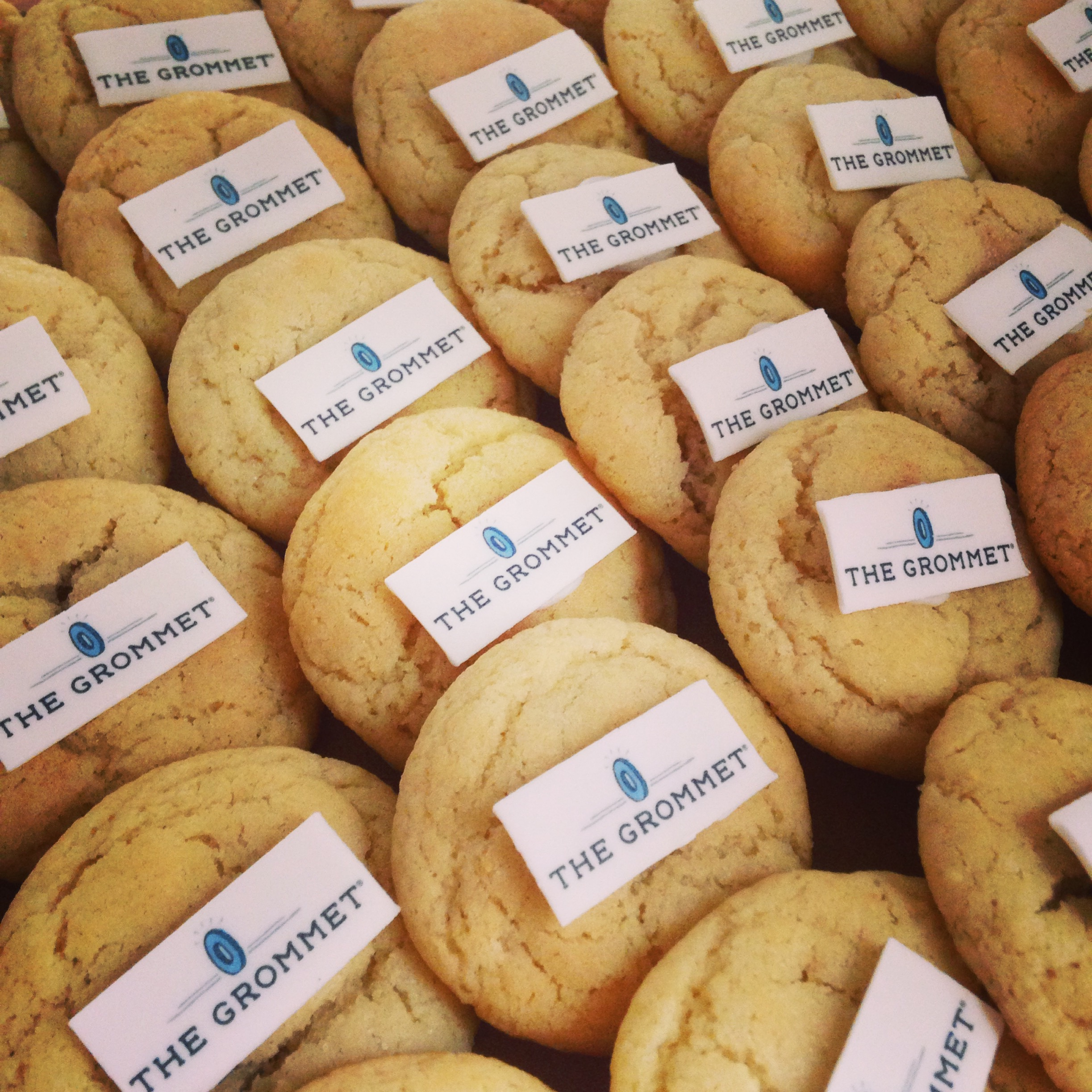 Custom cookies -- we'll print your logo, message, or photo on fondant and affix to any of our signature flavors!
