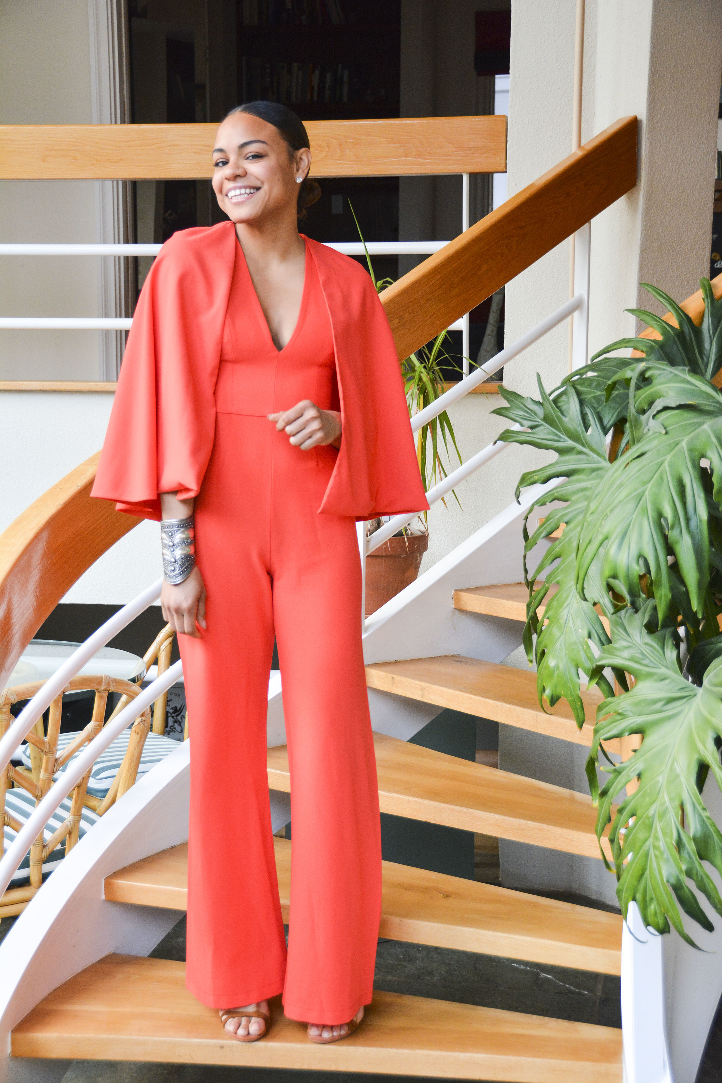 wearing: Jumpsuit by Alexis, shoes by Rebecca Minkoff