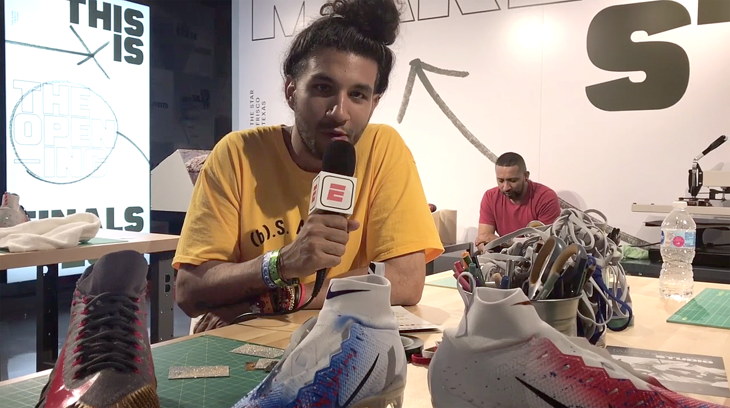 Photo:    ESPN     - 'Nike brought its Maker's Studio to Dallas, Texas for The Opening to allow high school football recruits and customers to customize their own football cleats and apparel. Cesar Perez, creator of Maker's Studio, talks about the process.'