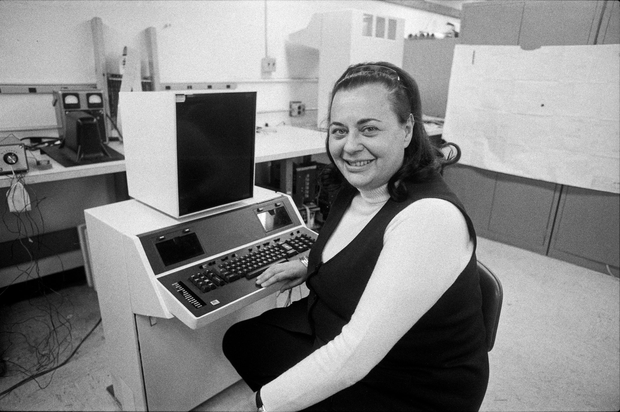 Evelyn Berezin in 1976, when she was president of the Redactron Corporation, with Data Secretary, the first computerized word processor, which she designed and marketed.CreditBarton Silverman/The New York Times